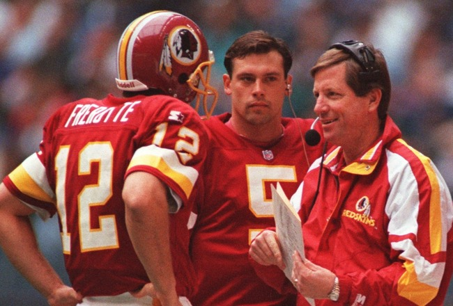28 Nov 1996: Head coach Norv Turner (right) talks with quarterbacks Gus Frerotte (left) and Heath Shuler (middle) of the Washington Redskins during a 21-10 loss to the Dallas Cowboys at Texas Stadium in Irving, Texas.