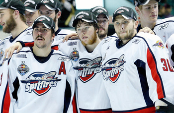 RIMOUSKI, QC - MAY 24:   Members of the Windsor Spitfires celebrate after defeating the Kelowna Rockets during the 2009 Mastercard Memorial Cup Final at the Rimouski Colisee on May 24, 2009 in Rimouski, Quebec, Canada.  The Spitfires defeated the Rockets