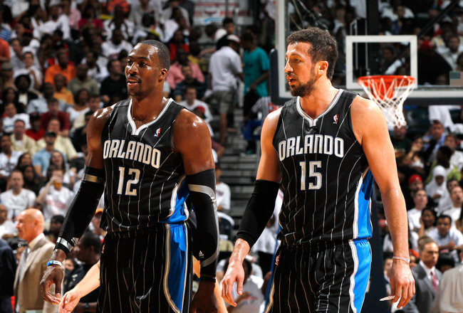 ATLANTA, GA - APRIL 24:  Dwight Howard #12 and Hedo Turkoglu #15 of the Orlando Magic against the Atlanta Hawks during Game Four of the Eastern Conference Quarterfinals in the 2011 NBA Playoffs at Philips Arena on April 24, 2011 in Atlanta, Georgia.  NOTE