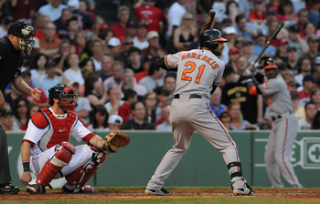 BOSTON, MA - JULY 09: Nick Markakis #21 of the Baltimore Orioles steps in to bat as catcher Jarrod Saltalamacchia #39 of the Boston Red Sox waits during the third inning at Fenway Park on July 9, 2011 in Boston, Massachusetts. The Boston Red Sox won the g
