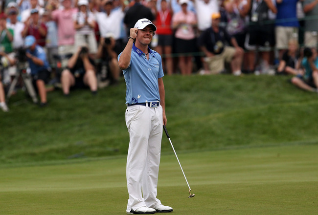BETHESDA, MD - JUNE 19:  Rory McIlroy of Northern Ireland celebrates his eight-stroke victory on the 18th green to win during the 111th U.S. Open at Congressional Country Club on June 19, 2011 in Bethesda, Maryland.  (Photo by Andrew Redington/Getty Image