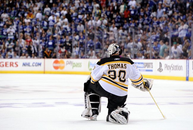 VANCOUVER, BC - JUNE 15:  Tim Thomas #30 of the Boston Bruins kneels on the ice during Game Seven against the Vancouver Canucks in the 2011 NHL Stanley Cup Final at Rogers Arena on June 15, 2011 in Vancouver, British Columbia, Canada.  (Photo by Harry How