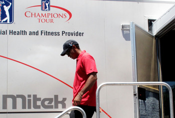 PONTE VEDRA BEACH, FL - MAY 09:  Tiger Woods walks out of the player fitness truck after withdrawing from the tournament on the seventh hole with a neck injury during the final round of THE PLAYERS Championship held at THE PLAYERS Stadium course at TPC Sa