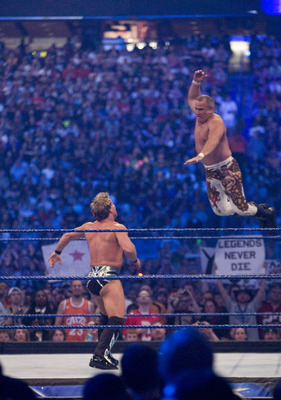 HOUSTON, TX - APRIL 5:  (L-R)  WWE Superstar Chris Jericho looks up as former professional wrestler Ricky 'The Dragon' Steamboat fly's toward him during WrestleMania 25 at Reliant Stadium on April 5, 2009 in Houston, Texas.  (Photo by Bill Olive/Getty Ima