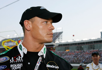 CONCORD, NC - MAY 26:  (R) Professional wrestler John Cena stands on pit road prior to the NASCAR Busch Series CARQUEST Auto Parts 300 on May 26, 2007 at Lowe's Motor Speedway in Concord, North Carolina.  (Photo by Kevin C. Cox/Getty Images)