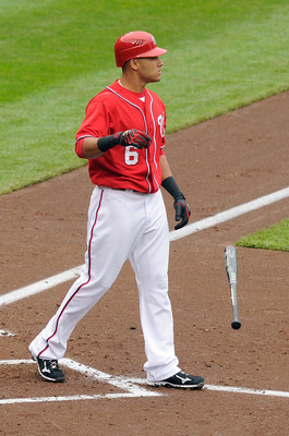 WASHINGTON, DC - MAY 01:  Ian Desmond #6 of the Washington Nationals tosses his bat after striking out to end the third inning against the San Francisco Giants at Nationals Park on May 1, 2011 in Washington, DC.  (Photo by Greg Fiume/Getty Images)