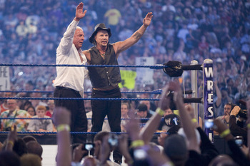 HOUSTON, TX - APRIL 5: (L-R) Actor Mickey Rourke celebrates with Ric Flair after beating WWE Superstar Chris Jericho during WrestleMania 25 at Reliant Stadium on April 5, 2009 in Houston, Texas.  (Photo by Bill Olive/Getty Images)
