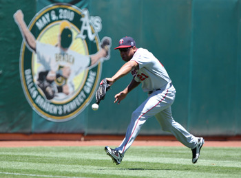OAKLAND, CA - JUNE 6:  Delmon Young #21 of the Minnesota Twins can't reach a ball hit by Ryan Sweeney of the Oakland Athletics in the second inning during an MLB game at the Oakland-Alameda County Coliseum on June 6, 2010 in Oakland, California. (Photo by