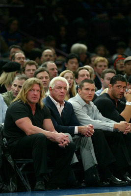 NEW YORK - MARCH 9:  WWE wrestlers (L-R) Triple H, Ric Flair, Randy Orton and Batista sit courtside at the New York Knicks v Boston Celtics  NBA game March 9, 2004 at Madison Square Garden in New York City.   (Photo by Ray Amati/Getty Images)