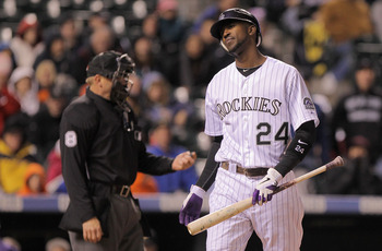 DENVER, CO - APRIL 29:  Dexter Fowler #24 of the Colorado Rockies reacts after striking out in the eighth inning against pitcher Chris Resop of the Pittsburgh Pirates at Coors Field on April 29, 2011 in Denver, Colorado. The Pirates defeated the Rockies 3