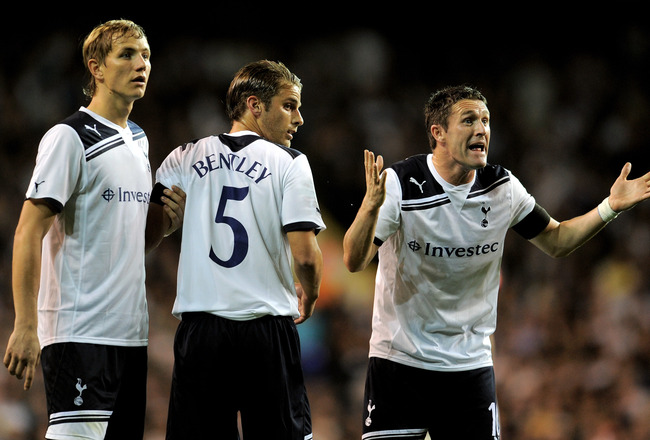 LONDON, ENGLAND - SEPTEMBER 21:  (R to L) Tottenham teammates Robbie Keane, David Bentley and Roman Pavlyuchenko form a defensive wall during the Carling Cup third round match between Tottenham Hotspur and Arsenal at White Hart Lane on September 21, 2010