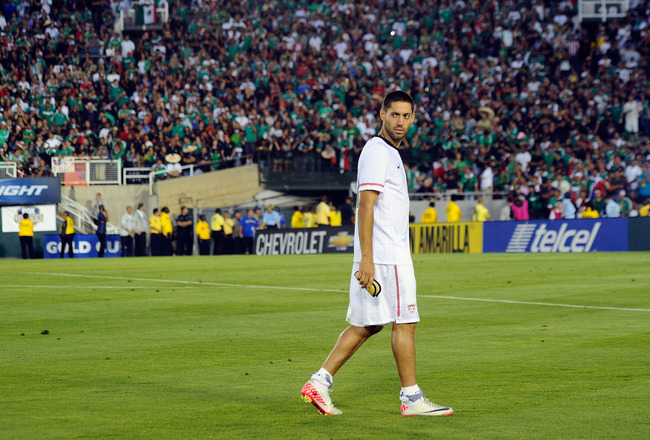 PASADENA, CA - JUNE 25: Clint Dempsey #8 of the United States reacts after receiving his silver medal follwoing his team's defeat to Mexico in the 2011 CONCACAF Gold Cup Championship at the Rose Bowl on June 25, 2011 in Pasadena, California.  (Photo by Ke