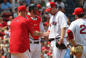 BOSTON, MA  - JULY 4:  Pitcher John Lackey #41 of the Boston Red Sox is removed from the game by Red Sox manager Terry Francona as Jarrod Saltalamacchia # 39 and Adrian Gonzalez # 28 of the Boston Red Sox looks on during a game against the Toronto Blue Ja