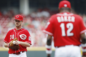 CINCINNATI, OH - JUNE 5: Travis Wood #30 of the Cincinnati Reds waits as manager Dusty Baker comes to the mound for a pitching change during the game against the Los Angeles Dodgers at Great American Ball Park on June 5, 2011 in Cincinnati, Ohio. (Photo b