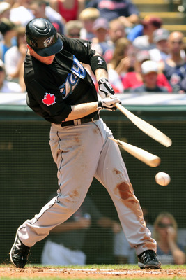 CLEVELAND, OH - JULY 10:  Aaron Hill #2 of the Toronto Blue Jays hits a broken bat ground ball for an out during the third inning against the Cleveland Indians at Progressive Field on July 10, 2011 in Cleveland, Ohio. (Photo by Jason Miller/Getty Images)