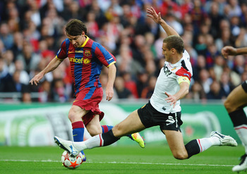 LONDON, ENGLAND - MAY 28:  Lionel Messi of FC Barcelona (L) is challenged by Nemanja Vidic of Manchester United during the UEFA Champions League final between FC Barcelona and Manchester United FC at Wembley Stadium on May 28, 2011 in London, England.  (P