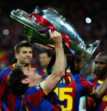 LONDON, ENGLAND - MAY 28: Lionel Messi of FC Barcelona celebrates with the trophy after victory during the UEFA Champions League final between FC Barcelona and Manchester United FC at Wembley Stadium on May 28, 2011 in London, England.  (Photo by Laurence