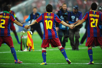 LONDON, ENGLAND - MAY 28:  Lionel Messi of FC Barcelona (C) celebrates with teammates after the UEFA Champions League final between FC Barcelona and Manchester United FC at Wembley Stadium on May 28, 2011 in London, England.  (Photo by Clive Mason/Getty I