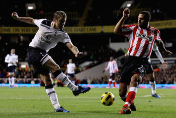 LONDON, ENGLAND - NOVEMBER 09: Tottenham's David Bentley (L) in action with Sunderland's Anton Ferdinand during the Premier League match between Tottenham Hotspur and Sunderland at White Hart Lane on November 9, 2010 in London, England.  (Photo by Scott H