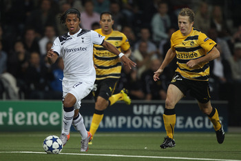 BERNE, SWITZERLAND - AUGUST 17:  Giovani dos Santos (l) of Tottenham shadowed by Christoph Spycher (r) of Young Boys during the UEFA Champions League Play-Off first leg match between BSC Young Boys and Tottenham Hotspur at the Stade de Suisse on August 17