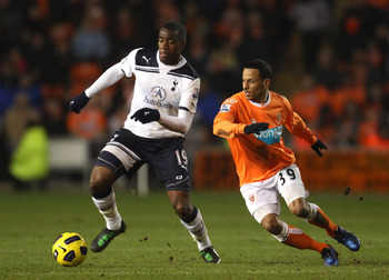 BLACKPOOL, ENGLAND - FEBRUARY 22:  DJ Campbell of Blackpool battles for the ball with Sebastien Bassong of Tottenham Hotspur during the Barclays Premier League match between Blackpool and Tottenham Hotspur at Bloomfield Road on February 22, 2011 in Blackp