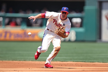 PHILADELPHIA - JULY 10: Second baseman Chase Utley #26 of the Philadelphia Phillies fields a ground ball during a game against the Atlanta Braves at Citizens Bank Park on July 10, 2011 in Philadelphia, Pennsylvania. (Photo by Hunter Martin/Getty Images)