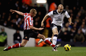 LONDON, ENGLAND - NOVEMBER 09: Tottenham's Alan Hutton (R) in action with Sunderland'sLee Cattermole during the Premier League match between Tottenham Hotspur and Sunderland at White Hart Lane on November 9, 2010 in London, England.  (Photo by Scott Heave