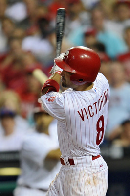 PHILADELPHIA, PA - JUNE 28: Shane Victorino #8 of the Philadelphia Phillies follows through on a two run home-run during the game against the Boston Red Sox at Citizens Bank Park on June 28, 2011 in Philadelphia, Pennsylvania. The Phillies won 5-0. (Photo