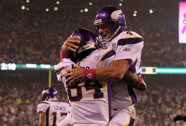 EAST RUTHERFORD, NJ - OCTOBER 11:  Brett Favre #4 and Randy Moss #84 of the Minnesota Vikings celebrate after Moss caught a 37-yard touchdown pass from Favre in the third quarter against the New York Jets at New Meadowlands Stadium on October 11, 2010 in