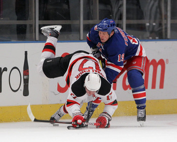 NEW YORK, NY - APRIL 09:  Ruslan Fedotenko #19 of the New York Rangers trips up Ilya Kovalchuk #17 of the New Jersey Devils at Madison Square Garden on April 9, 2011 in New York City. The Rangers defeated the Devils 5-2.  (Photo by Bruce Bennett/Getty Ima