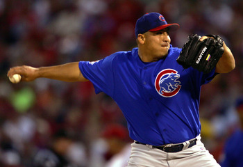 ST. LOUIS - APRIL 20:  Carlos Zambrano #38 of the Chicago Cubs delivers a pitch in the first inning against the St. Louis Cardinals on April 20, 2005 at Busch Stadium in St. Louis, Missouri.  (Photo by Elsa/Getty Images)