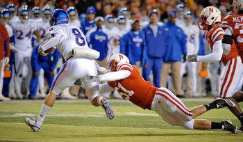 LINCOLN, NE - NOVEMBER 13: Quinn Mecham #8 of the Kansas Jayhawks is brought down by Will Compton #51 of the Nebraska Cornhuskers during first half action of their game at Memorial Stadium on November 13, 2010 in Lincoln, Nebraska. Nebraska  (Photo by Eri