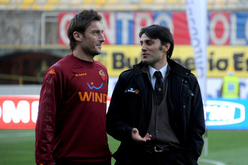 BOLOGNA, ITALY - FEBRUARY 23:  Roma coach, Vincenzo Montella speaks with Francesco Totti before the Serie A match between Bologna FC and AS Roma at Stadio Renato Dall'Ara on February 23, 2011 in Bologna, Italy.  (Photo by Roberto Serra/Getty Images)
