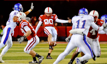 LINCOLN, NE - NOVEMBER 13: Alex Henery #90 of the Nebraska Cornhuskers punts the ball away during their game against the Kansas Jayhawks at Memorial Stadium on November 13, 2010 in Lincoln, Nebraska. Nebraska Defeated Kansas 20-3. (Photo by Eric Francis/G