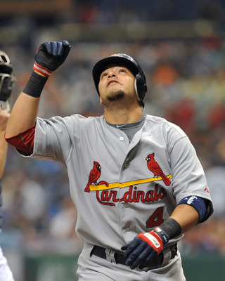 ST. PETERSBURG, FL - JULY 3:  Catcher Yadier Molina #4 of the St. Louis Cardinals celebrates a home against the Tampa Bay Rays  July 3, 2011 at Tropicana Field in St. Petersburg, Florida.  (Photo by Al Messerschmidt/Getty Images)