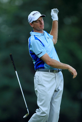 BETHESDA, MD - JUNE 17:  Jim Furyk reacts to his second shot on the eigth hole during the second round of the 111th U.S. Open at Congressional Country Club on June 17, 2011 in Bethesda, Maryland.  (Photo by David Cannon/Getty Images)