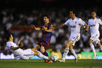 VALENCIA, SPAIN - APRIL 20: Lionel Messi of FC Barcelona (C) is tackled by Ricardo Carvalho (L) and Alvaro Arbeloa of Real Madrid (2ndR) during the Copa del Rey Final between Real Madrid and Barcelona at Estadio Mestalla on April 20, 2011 in Valencia, Spa