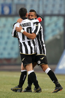 UDINE, ITALY - JANUARY 06: Alexi Sanchez (R) and Antonio di Natale of Udinese Calcio celebrate after scoring a goal during the Serie A match between Udinese and Chievo at Stadio Friuli on January 6, 2011 in Udine, Italy.  (Photo by Gabriele Maltinti/Getty