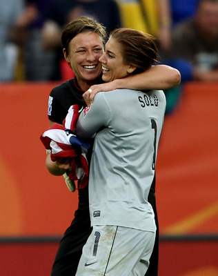 DRESDEN, GERMANY - JULY 10:  Hope Solo of USA (R) celebrates with Abby Wambach after victory in the penalty shoot out during the Women's World Cup Quarter Final match between Brazil and USA at Rudolf-Harbig Stadium on July 10, 2011 in Dresden, Germany.  (