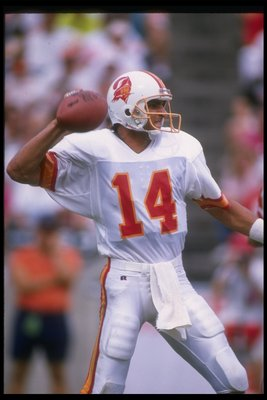 24 Sep 1989:  Quarterback Vinny Testaverde of the Tampa Bay Buccaneers looks to pass the ball during a game against the New Orleans Saints at the Superdome in New Orleans, Louisiana.  The Buccaneers won the game, 20-10. Mandatory Credit: Allen Dean Steele