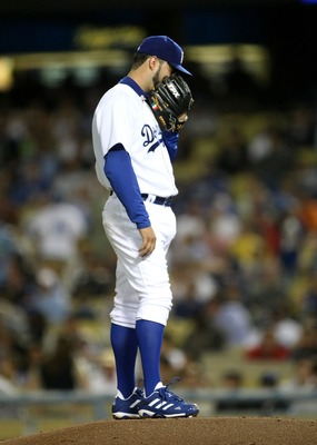 LOS ANGELES, CA - SEPTEMBER 11:  Pitcher Esteban Loaiza #25 of the Los Angeles Dodgers reacts after giving up back to back home runs against the San Diego Padres in the third inning on September 11, 2007 at Dodger Stadiium in Los Angeles, California.  (Ph