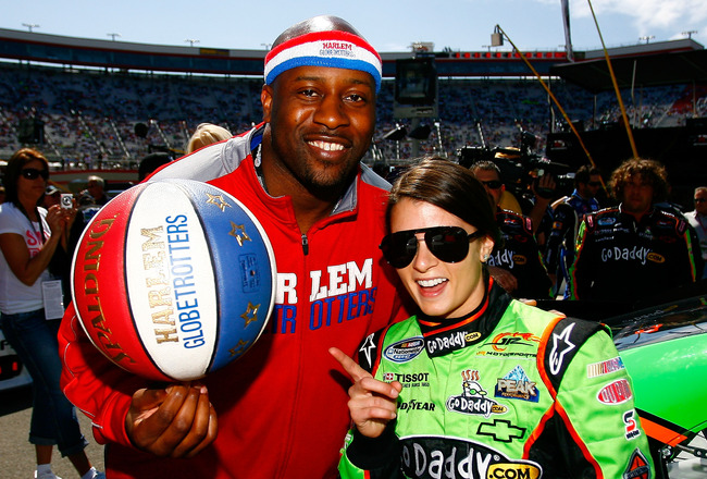 BRISTOL, TN - MARCH 19:  Danica Patrick (R), driver of the #7 GoDaddy.com Chevrolet, poses with Harlem Globetrotter's Hot Shot Branch (L) on the grid prior to the start of the NASCAR Nationwide Series Scotts EZ Seed 300 at Bristol Motor Speedway on March