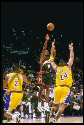 25 Oct 1997:  Dale Ellis #9 of the Seattle Supersonics shoots over Derek Fisher #2 and Shea Seals #24 of the Los Angeles Lakers during the Sonics 85-79 loss at the Great Western Forum in Inglewood, California.  Mandatory Credit: Otto Greule  /Allsport