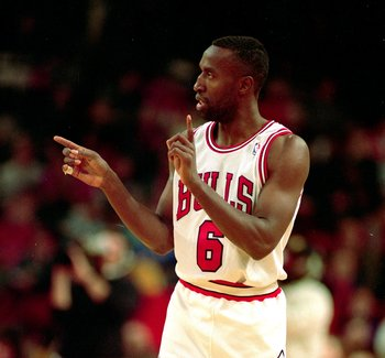 14 Nov 1992: Trent Tucker #6 of the Chicago Bulls points on the court  during a game against the Denver Nuggets.  Mandatory Credit: Jonathan Daniel  /Allsport