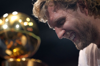 DALLAS, TX - JUNE 16:  Dirk Nowitzki of the Dallas Mavericks talks after the Dallas Mavericks Victory Parade at American Airlines Center on June 16, 2011 in Dallas, Texas.  (Photo by Ronald Martinez/Getty Images)