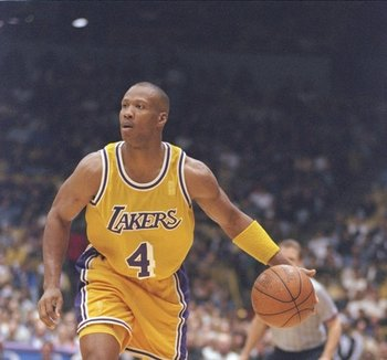 10 Jan 1997:  Guard Byron Scott of the Los Angeles Lakers dribbles the ball down the court during a game against the Miami Heat at the Great Western Forum in Inglewood, California.  The Lakers won the game 94-85. Mandatory Credit: Elsa Hasch  /Allsport