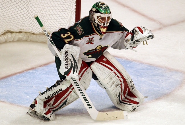 CHICAGO, IL - JANUARY 25: Niklas Backstrom #32 of the Minnesota Wild sets to protect the goal against the Chicago Blackhawks at the United Center on January 25, 2011 in Chicago, Illinois. The Wild defeated the Blackhawks 4-2. (Photo by Jonathan Daniel/Get