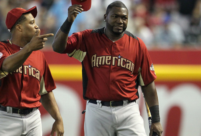 PHOENIX, AZ - JULY 11:  (L-R) American League All-Stars Robinson Cano #24 of the New York Yankees and David Ortiz #34 of the Boston Red Sox talk on the field during the Gatorade All-Star Workout Day at Chase Field on July 11, 2011 in Phoenix, Arizona.  (P