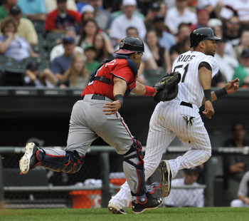 CHICAGO, IL - JUNE 25: Alex Rios # 51 of the Chicago White Sox is tagged out by Ivan Rodriguez #7 of the Washington Nationals on June 25, 2011 at U.S. Cellular Field in Chicago, Illinois. The White Sox defeated the Nationals 3-0.  (Photo by David Banks/Ge