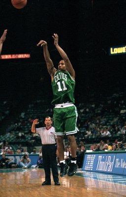 19 Oct 1999: Dana Barros #11 of the Boston Celtics takes a shoot during a game against the Charlotte Hornets at the Charlotte Coliseum in Charlotte, North Carolina. The Hornets defeated the Celtics 120-117..